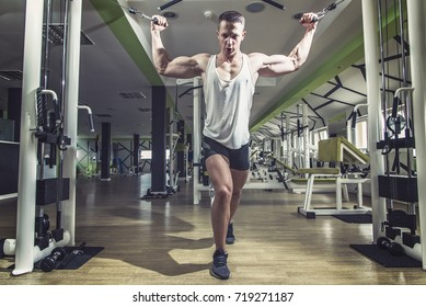 Man doing cable fly exercise in gym