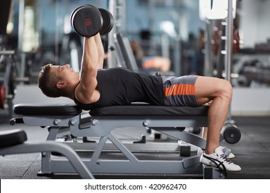 Man doing chest workout, bench press with dumbbells