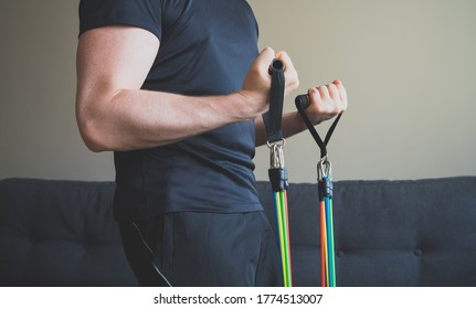 Man doing exercises with resistance bands at home.