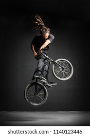 A man doing an extreme stunt on his BMX bicycle. Professional rider. Sport.