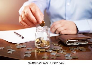 Man doing finances and calculate home budget, saving money, finance