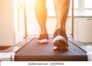Man doing fitness on a treadmill