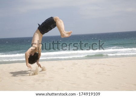 a647bea6eacbab Man Doing Flips Beach Stock Photo (Edit Now) 174919109 - Shutterstock