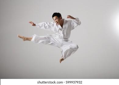 Man doing a flying kick, martial arts