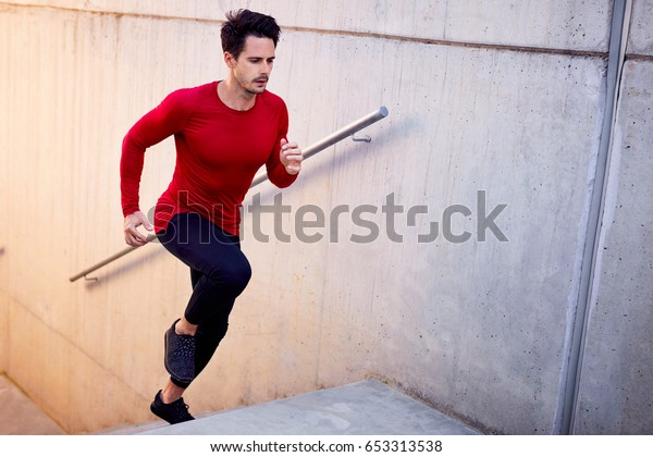 Man doing hiit workout on stairs. Urban fitness