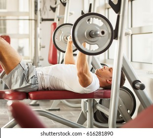 Man doing his chest workout on bench press.