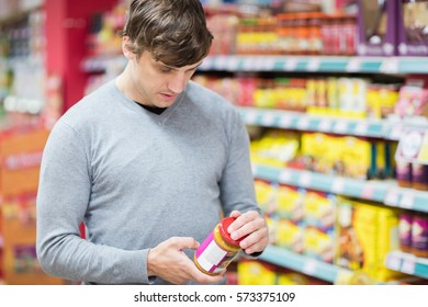 Man doing his groceries in the supermarket
