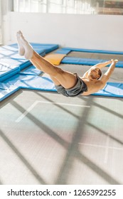 man is doing jumps on the trampoline. close up shot. full leength phot. copy space.