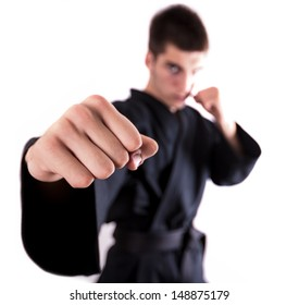 A man doing kickboxing and throwing a punch. Focus on the fist.