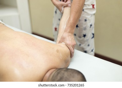 the man is doing a massage