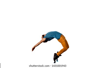 Man is doing modern dance twisting on a white background