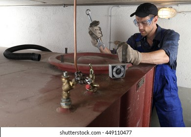 Man doing Oil tank Tank cleaning