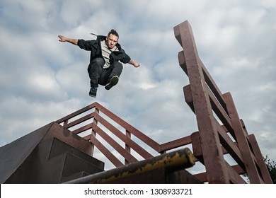 Man doing parkour in city. Athlete practicing freerunning.