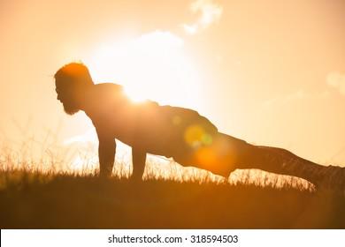 Man doing push ups outdoors