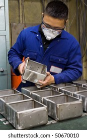 Man doing quality control checking on stainless steel fabricated product