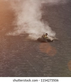 Man doing sandboarding in cerro negro volcano Nicaragua