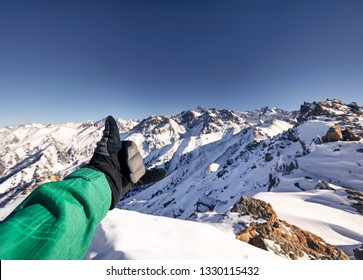 Man doing shaka gesture on the mountain peak with amazing view