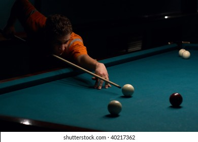 Man doing shoot on billiard