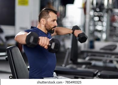 Man doing shoulder workout with dumbbells