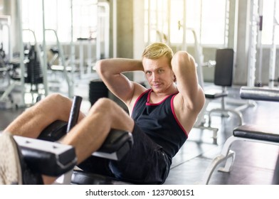 Man doing situp or crunches in gym,Men exercise muscular his stomach in door