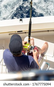 man doing sport fishing on a boat