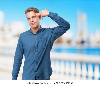 man doing a sucide gesture