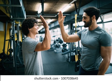 Man doing workout with a personal trainer.