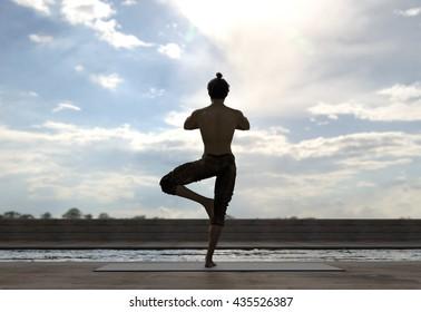 man doing yoga around pool - tree pose (Vrksasana) - 3d rendering