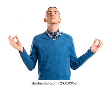 Man doing zen gesture over white background