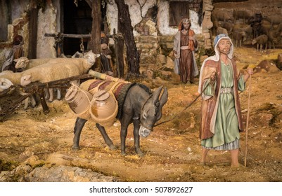 Man and donkey in a christmas creche