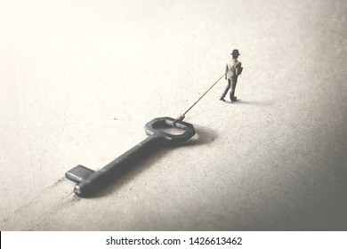 man drag a big heavy key, access surreal concept