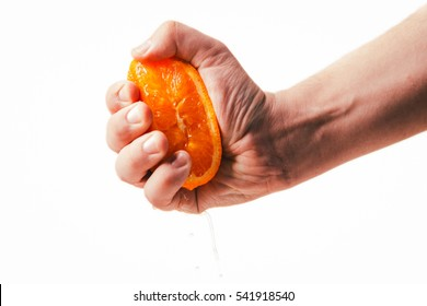 man dramatic squeezes orange. Concept squeezed a man  is tired from work.