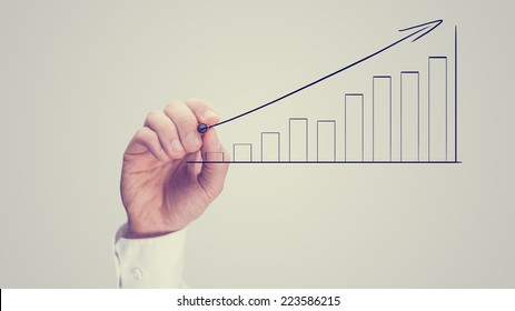 Man drawing an ascending bar graph on a virtual interface conceptual of analysis, performance growth and planning, vintage effect with copyspace.