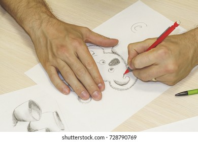 Man drawing coala by pencil. Drawing lesson.  Close up man hand with pencil.