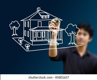 man drawing dream home