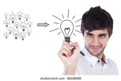 Man drawing a message in a whiteboard, how to manage creativity turning many ideas in one good idea (selective focus)