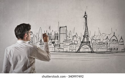 Man drawing a picture of Paris