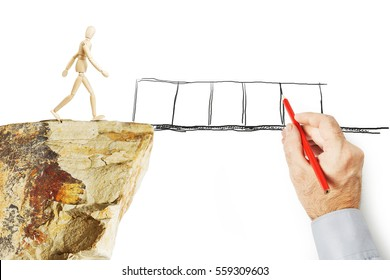 Man draws a bridge and saves other person from falling in the precipice. Conceptual image with pencil drawing