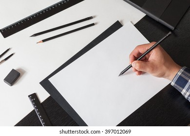 Man draws a sketch on the table, architector