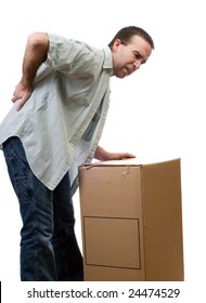 A man dressed in casual clothing, hurt his back lifting a large box, isolated against a white background