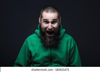 Man, dressed in a green swatshirt, screaming