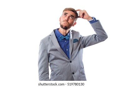 Man dressed as his head scratching like a pensive gesture, isolated on white background