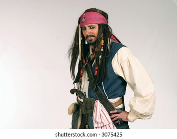 man dressed as pirate with hands on hips