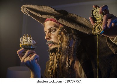 a man dressed in a pirate suit