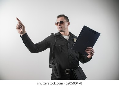 a man dressed in a police costume USA, finger points