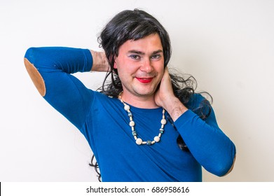 Man dressed as woman isolated on white background