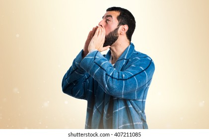 Man in dressing gown shouting