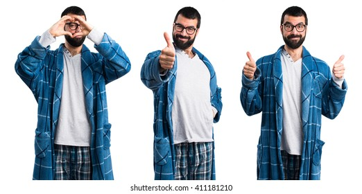 Man in dressing gown with thumb up