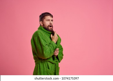 man in a dressing gown yawns, morning, comfort