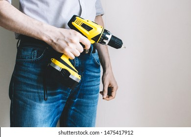 man with a drill in his hand